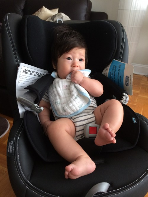 4 Month Old Sitting In Primo Viaggio Convertible Car Seat